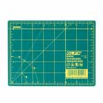 Whether you're new to crafting or a pro, you'll appreciate this OLFA® rotary mat. It not only protects your cutting surfaces, it protects the edges of rotary blades. The mat's grid lines are designed for easy measuring and accurate cutting of straight lines and precise angles. Good For: protecting cutting surfaces and extending the life of your rotary blades. 1.5mm thick. Double-sided mat is solid green on one side for general crafting and has yellow grid lines on other side for detailed cutting. Self-healing finish reseals surface cuts, providing a continually smooth surface for all cutting projects. Store flat and out of direct sunlight. For use only with rotary blades and blades; fixed-blade knives blade may damage mat. Mat: 6 1/2″ x 9″ (17 x 23 cm). Grid: 6″ x 8″ (15 x 20 cm)